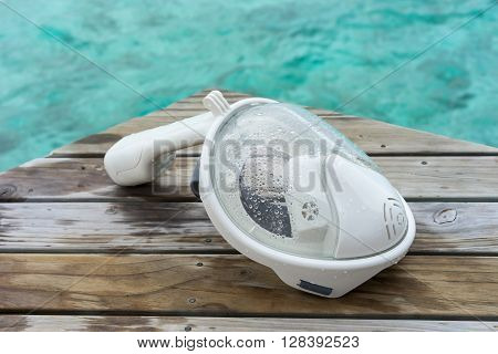 white Snorkeling Mask on Dock at sea Maldives