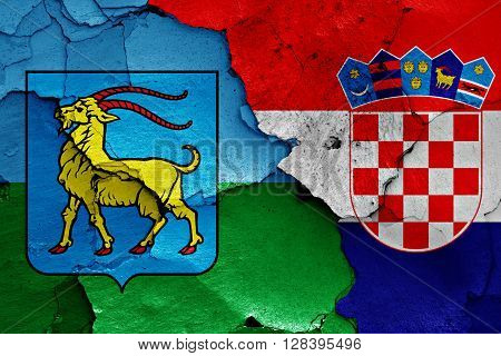 flags of Istria County and Croatia painted on cracked wall
