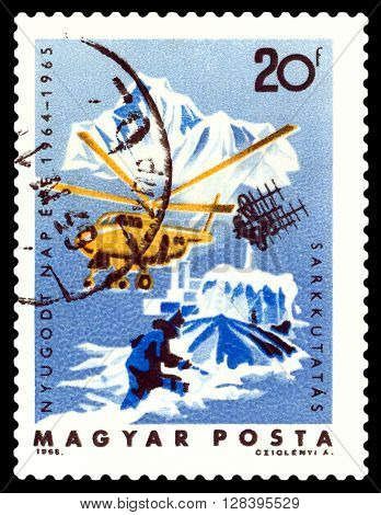 STAVROPOL RUSSIA - MARCH 30 2016: A stamp printed in the Hungary it shows a helicopter polar town Arctic exploration circa 1965