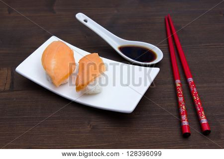 Nigiri with salmon on a wooden table