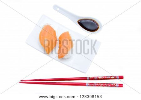 Nigiri with salmon on a white background seen from above