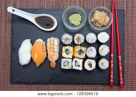 Sushi on flat slate on a placemat bamboo seen from above
