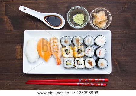 Tray of sushi on a wooden table seen from above