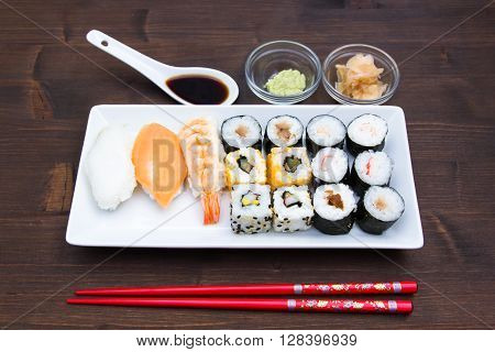 Tray of sushi on a wooden table