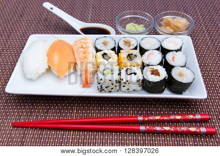 Tray of sushi on a bamboo mat