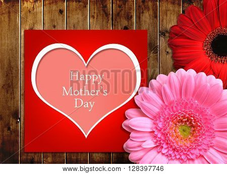 Mothers day card with gerbera flowers on wooden board