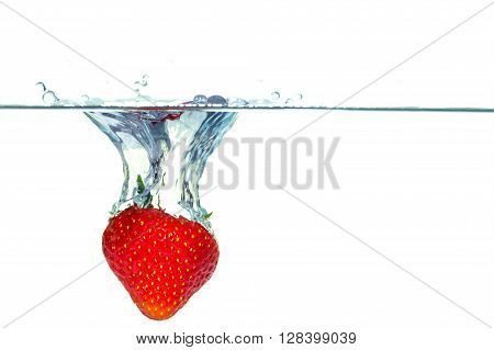 Strawberry Falling Into Water With A Splash