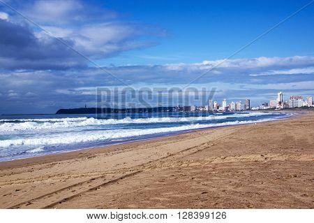 Empty Beach Against City Skyline In Durbansouth Africa