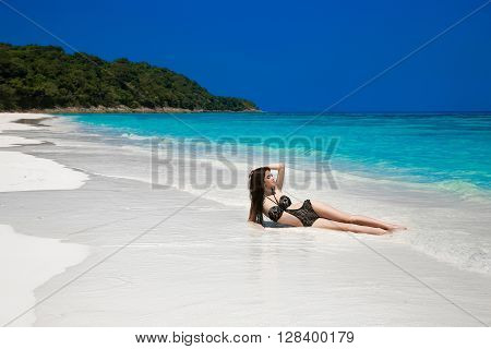 Beautiful Sexy Bikini Girl Model Sun Tanned On Tropical Beach. Outdoor Portrait Of Slim Brunette Wom