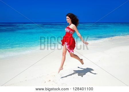 Beautiful Free Girl Running On Exotic Beach With White Sand And Blue Water. Happiness Bliss Freedom