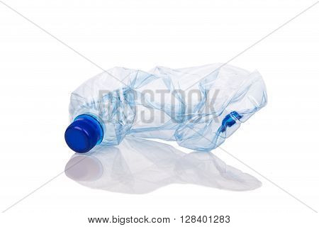 Mineral Water Bottle Crushed And Crumpled Against White Background