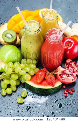 Color Juices Smoothie Bottles Red Green Orange Fruits Water Melon Apple Strawberry Kiwi Grapes Mango Pomegranate Tropical Selective Focus Black Background Healthy Beverage