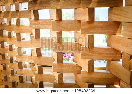 Brown wooden wall built out of small plates