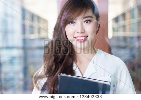 young beautiful asian girl university student in library
