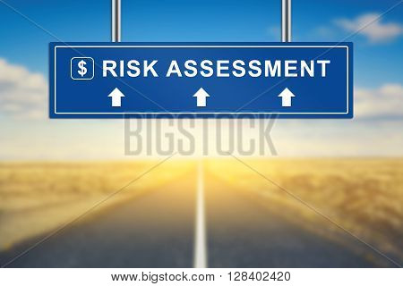 risk assessment words on blue road sign with blurred background