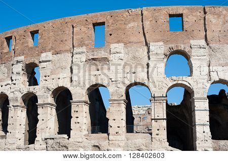 Colosseum Part With Summer Blue Sky