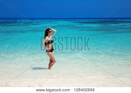 Beautiful Sexy Bikini Girl Model Sun-tanned On Tropical Beach. Outdoor Portrait Of Slim Brunette Wom