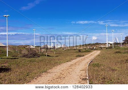 Dirt Road Leading Through Natural Picnic Area On Beachfront