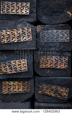 Wooden Railway sleepers in a pile with metal