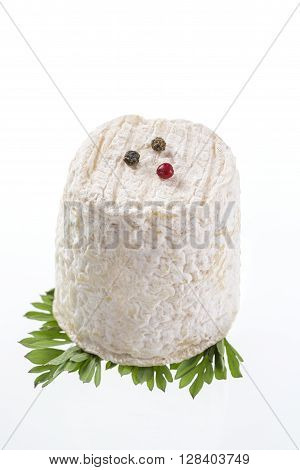 french goats cheeses with herbs on white background