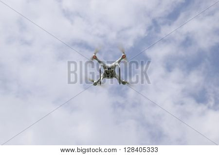 Flight Quadrocopters White Against The Blue Sky With Clouds