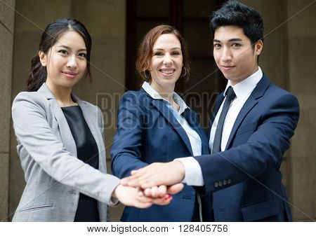 Business people hand joining