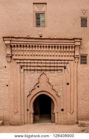 TAMNOUGALT, MOROCCO - OCTOBER 23, 2015: Side entrance to Kasbah Tamnougalt in the Draa valley Morocco.