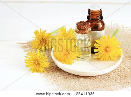 Dandelion in skincare cosmetic products. Flowers and natural flower water. Herbal natural cosmetics.