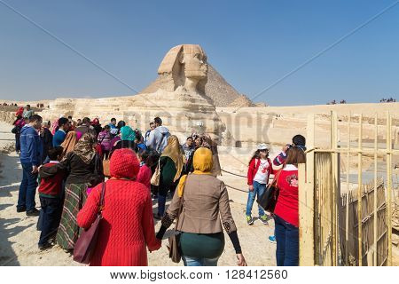 CAIRO, EGYPT - FEBRUARY 3, 2016: Group of tourists around the Great Sphinx of Giza, Egypt.
