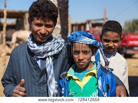 DARAW, EGYPT - FEBRUARY 6, 2016: Portrait of group of local boys at Camel market.