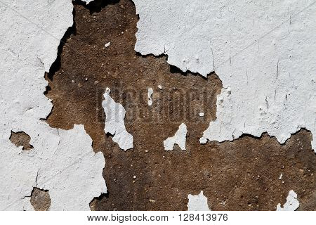 cracked white colour on a stone wall texture