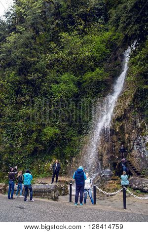 Ritsinsky reserve, Abkhazia - April 22: Waterfall in the Republic of Abkhazia North Caucasus male tears, tourists take pictures and enjoy nature on April 22, 2016
