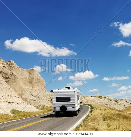 Recreational vehicle on scenic road in Badlands National Park, North Dakota.