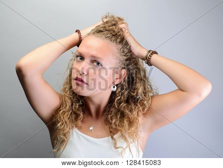 Curly Woman Pulling Her Hair