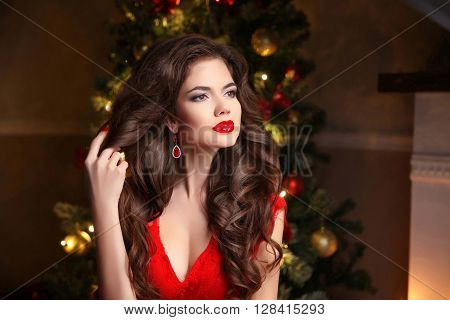 Long Hair. Makeup. Christmas Woman. Beautiful Girl Portrait. Elegant Lady In Red Dress With Wavy Hea