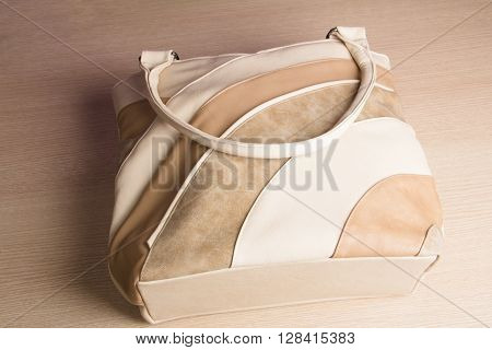 Women handbag on table . Women handbag