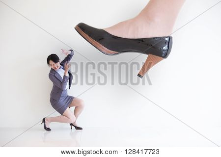 business woman steping on a fear woman business concept asian model