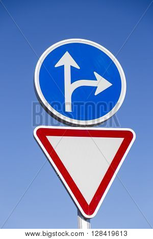 traffic signal caution and red and blue triangle and circle obligation