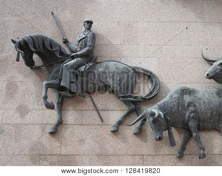 Madrid Spain - April 11 2016: Large Bronze Sculpture on wall at Madrid Bullring. Madrid Spain - April 11 2016