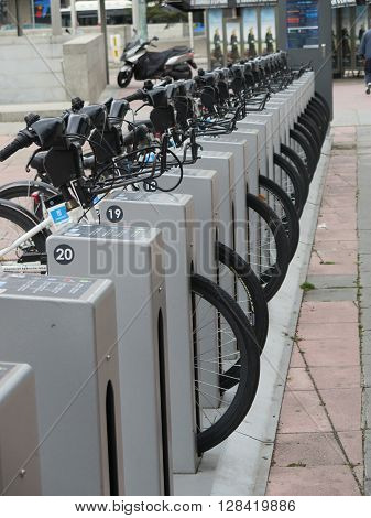 Madrid Spain - April 11 2016: Row of bikes for rent outside main railway station in Madrid. Madrid Spain - April 11 2016