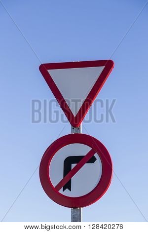 red traffic signal caution and red triangle and circle prohibition