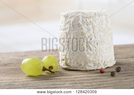 traditional french goats cheeses on white  background