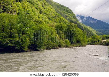 rapid mountain river in Abkhazia in the spring morning, with mountains