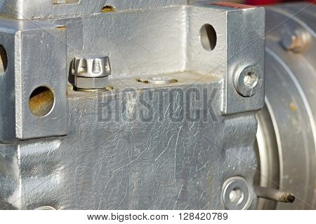 part of a casing of a reducer closeup of gray steel color for an industrial mechanical background