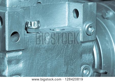 part of a casing of a reducer closeup of blue silvery color for an industrial mechanical background