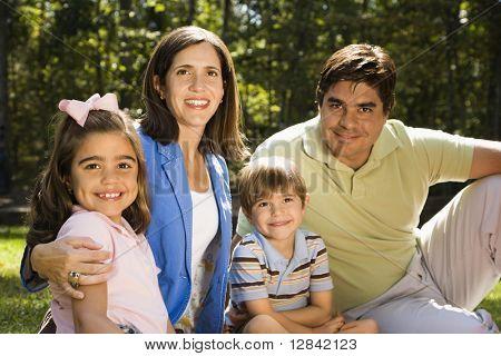 Hispanic outdoor family portrait.