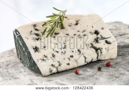 Slice of Roquefort traditional french  cheese on white background