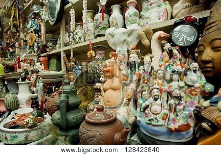 HONG KONG, CHINA - FEB 12, 2016: Antique market porcelain and old statues for sale at second hand store on February 12, 2016. More than 47 million tourists visit Hong Kong annually