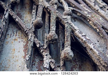 texture of the three rods made of iron and old paint blue and brown on old gate
