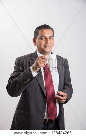 indian businessman having coffee or tea, asian businessman and coffee or tea, businessman drinking coffee in big white cup, isolated over white background